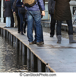 People walking?on?the?catwalk in Venice Italy