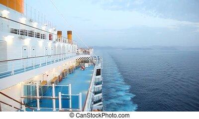 people walks on cruise ship in sea