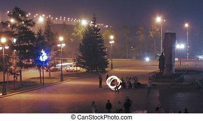 people walks on square at night