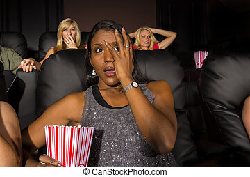 People Watching A Movie - A group of people watching a movie...