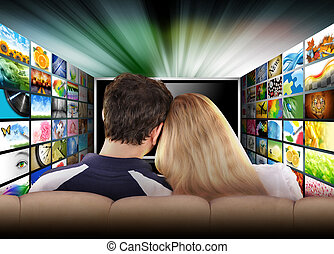 People Watching Television Movie Screen - A couple is ...