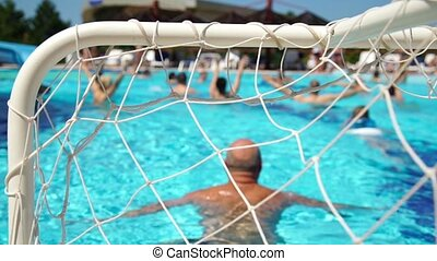 People water polo play in the pool, conceptual of a summer vacation and travel