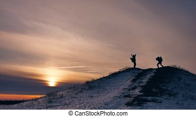 people winter jumps silhouette photograph joy snow sunlight....