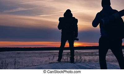 people winter silhouette photograph joy snow sunlight. group...