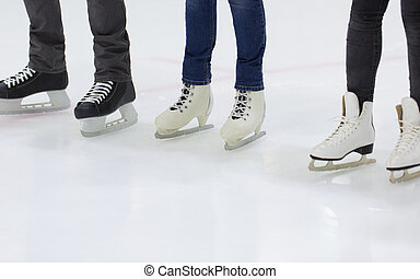 close up of legs in skates on skating rink
