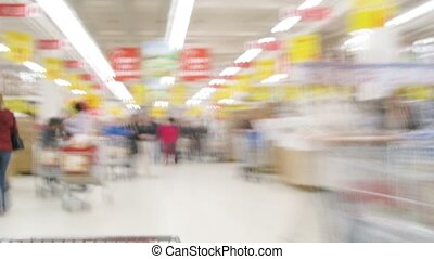 People with carts in a supermarket in Moscow, Russia.