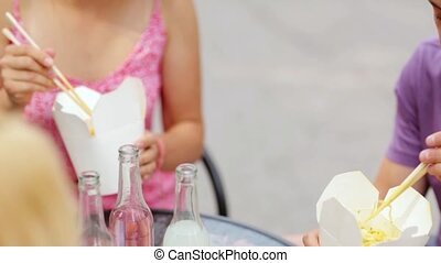 people with chopsticks eating wok outdoors - leisure, food...