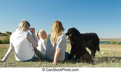 People With Dogs Enjoying Outdoors - People enjoying in the...