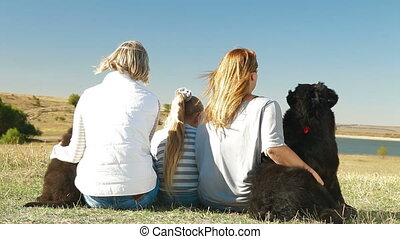 People with Dogs Resting - People with Newfoundland dogs...