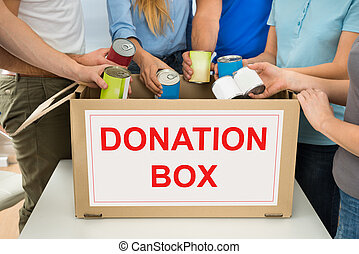 People With Donation Box Holding Cans - Group Of People...