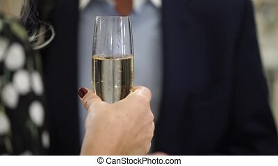 People with glasses of champagne staying at event