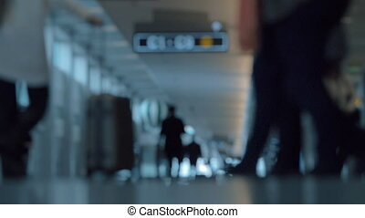 People with luggage in airport hall, defocus - Slow motion...