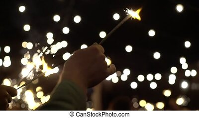 People with sparkles fire slowmotion