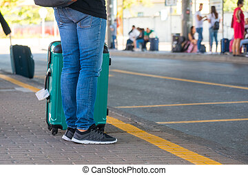 People with suitcases at the bus station