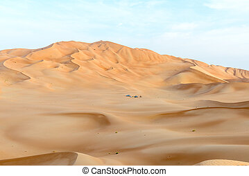 People with tents and cars among dunes in Rub al-Khali ...