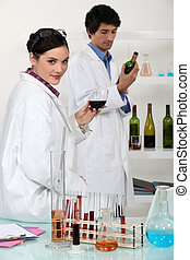 People working in a wine laboratory