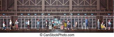 People Working In Data Center Room Hosting Server Computer Monitoring Information Database