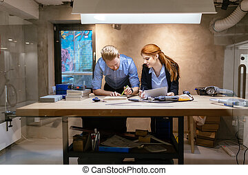 People working in modern beautiful workshop