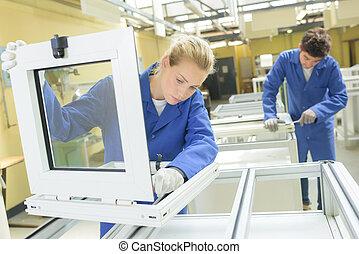 People working in window factory