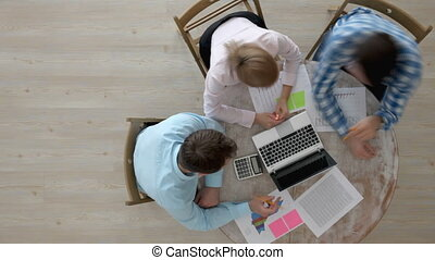 People working with reports