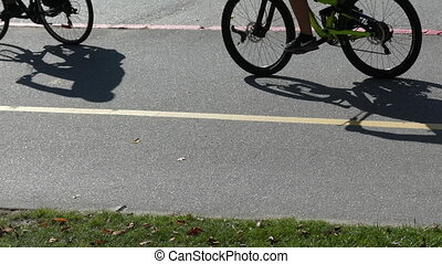 Peple riding bicycles sunny day high angle view slomo -...