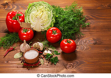 Pepper and tomatoes with garlic on a vintage wooden table with label