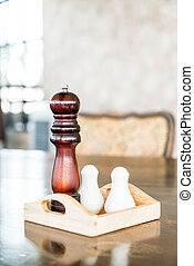 Pepper grinder and saltshaker on the table