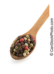 pepper in spoon on white