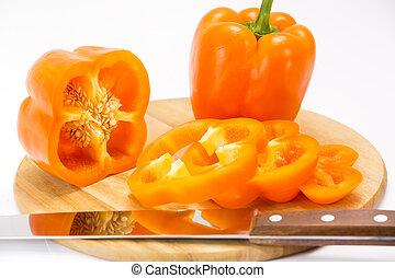 pepper on a cutting board