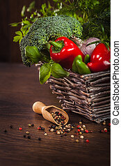 Pepper on wood with vegetables in basket
