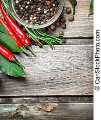 Pepper peas in a bowl with Bay leaves and red pepper.