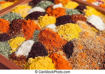 Multi color pepper powder and other herbal spice condiment ingredients at food market