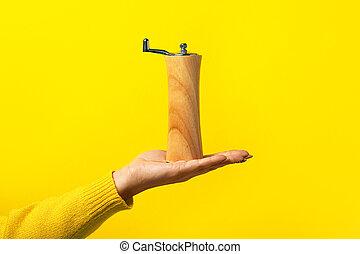 pepper shaker on hand - pepper shaker on female hand over ...