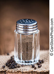 Pepper Shaker(selective focus) on an old wooden table (close...
