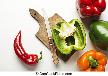 Pepper vegetable - Red, green and orange bell peppers on...