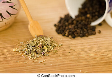 Pepper with Origan - some peppercorns that come out of a cup...