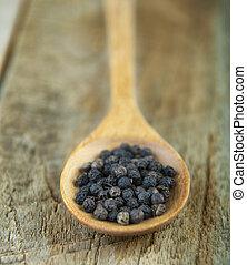peppercorn in spoon