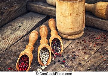 peppercorn in wooden spoons