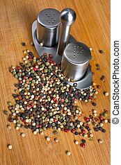 peppercorns on a wooden board