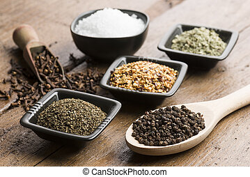 peppercorn,salt and spices. - peppercorn in spoon with...