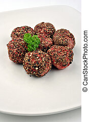 peppered meat balls with organic parsley on a plate
