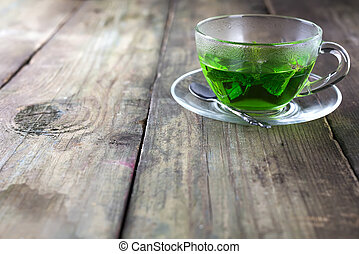 Peppermint tea in a glass cup on the table