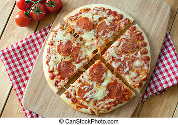 Pepperoni pizza slices - Delicious Italian pizza slices with...