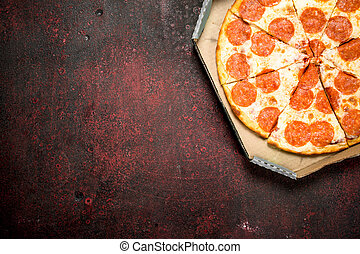 On A Rustic Background Pepperoni Pizza With Sausage And Cheese