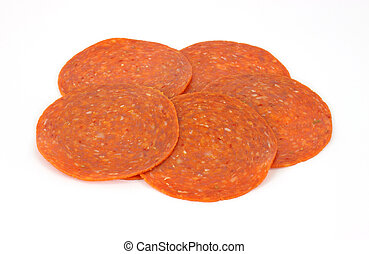 A small group of fresh pepperoni slices on a white background.