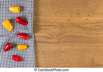 Peppers on wooden background.