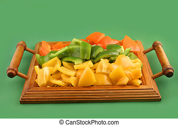 peppers - cut up green, yellow and orange peppers