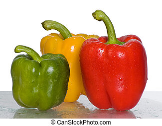 Peppers. Three peppers on a white background. Focus on the red one