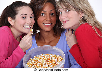 Peppy women eating popcorn