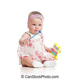 pequeno, brinquedo, musical, menina bebê, tocando